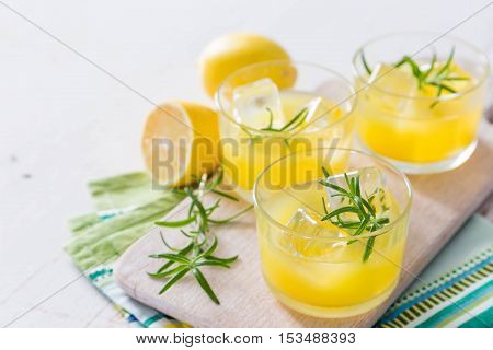 Lemon and rosemary cocktails with copy space