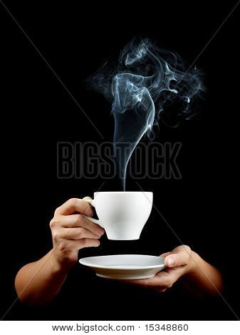 Cup of coffee in the women's hand on black background