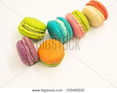 Colorful macaron cookies on white background select and soft focus