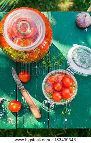 Closeup Of Ingredients For Pickled Tomatoes In The Jar