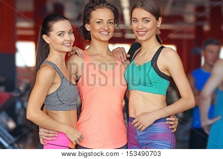 Portrait of young sportive women in gym