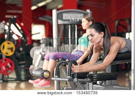 Young women training in modern gym