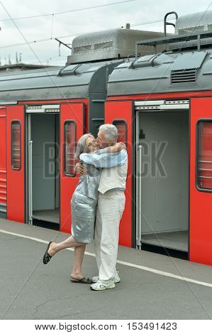 Mature vital elderly couple at the train station
