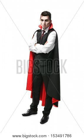 Young man dressed in vampire costume for Halloween, isolated on white