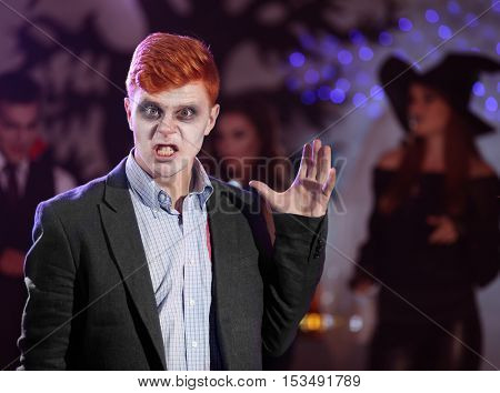Guy dressed as dead man at Halloween party