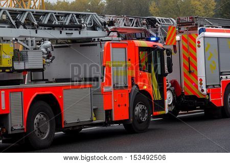 HANNOVER / GERMANY - OCTOBER 25 2016: german firefighting trucks stands on freeway a2 by a truck crash near Hannover.