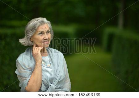 Nice elderly woman resting in a summer