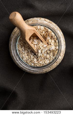 Dry rolled oatmeal in glass jar. Top view.