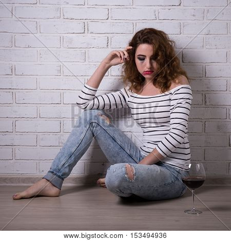 Depression And Alcoholism - Young Woman Sitting On The Floor With Glass Of Wine