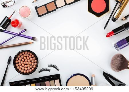 top view of cosmetics on white with copy space
