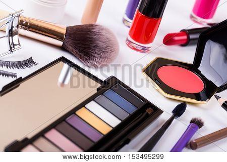 closeup shot with variety of makeup cosmetics