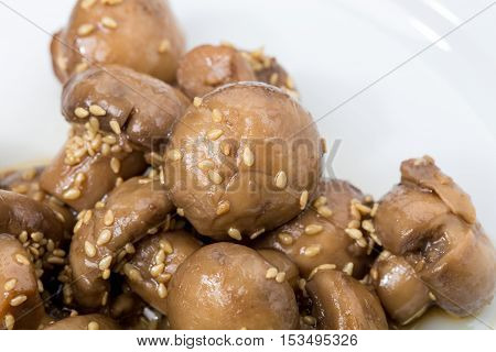Roasted champignons with sesame in asian style. Macro. Photo can be used as a whole background.