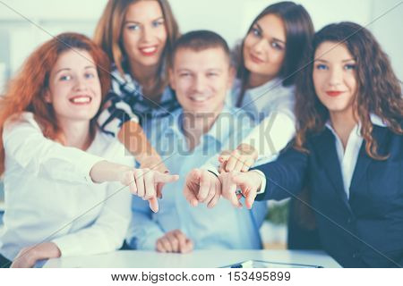 Business people group team point finger at you, in office