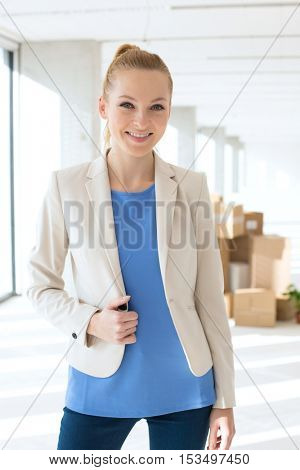 Portrait of beautiful young businesswoman smiling in new office