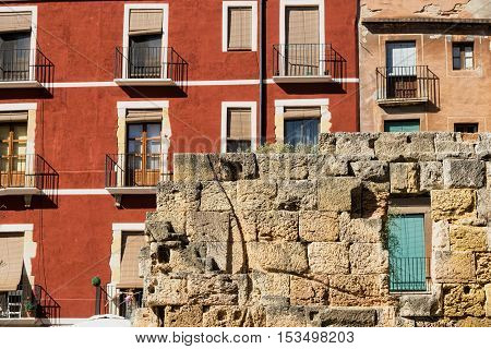 Tarragona (Catalunya Spain): old street in the gothic quarter near the medieval cathedral with colorful houses and ruins of walls