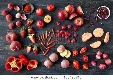 Collection of raw produce red fruits and vegetables, fresh organic healthy flat layout background