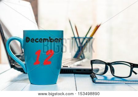 December 12th. Day 12 of month, calendar on Database Administrator workplace background. Winter time. Empty space for text.