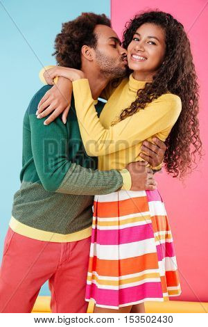 Happy african young couple in love kissing and hugging