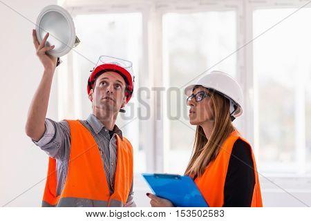 Maintenance Engineers Checking Light