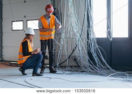 Maintenance Engineers checking electricity, toned image, Maintenance Engineers checking electricity, horizontal image
