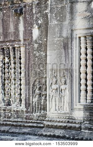 ancient asian stone carved figures in buddhist angkor wat temple cambodia