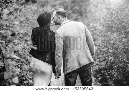 Pretty Couple Walking Outdoor In The Park