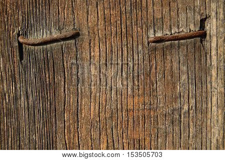 wooden background with nail, wood texture, cracked surface