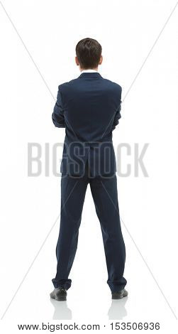 Businessman from the back - looking at something over a white ba