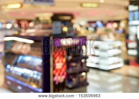 SINGAPORE - CIRCA SEPTEMBER, 2016: defocused shot of a cosmetics store. Cosmetics, also known as make-up, are substances or products used to enhance the appearance or fragrance of the body.