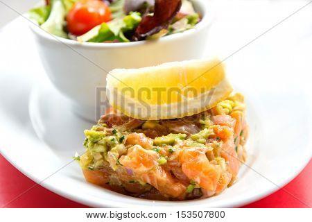 A seafood salad with smoked saA seafood salad with smoked salmonlmon