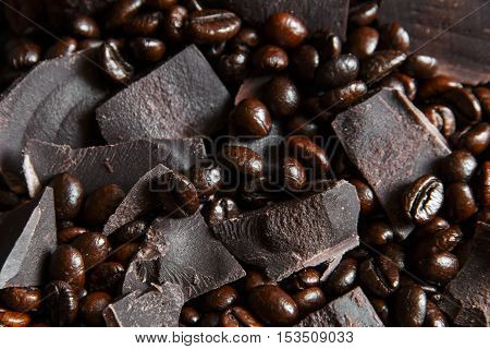 roasted coffee beans with black chocolate closeup