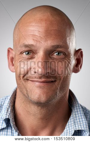 Happy smiling caucasian white man portrait of real person in studio. full collection of diverse faces in this set.