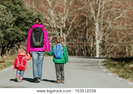 mother with two kids go to school or daycare