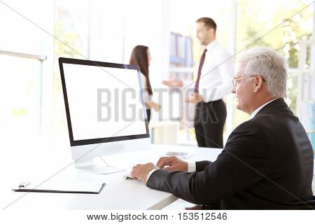 Business training concept. Businessman working on computer in office