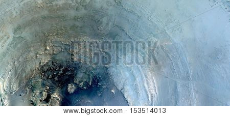 the wishing well in the desert, Abstract photography of landscapes of deserts of Africa from the air