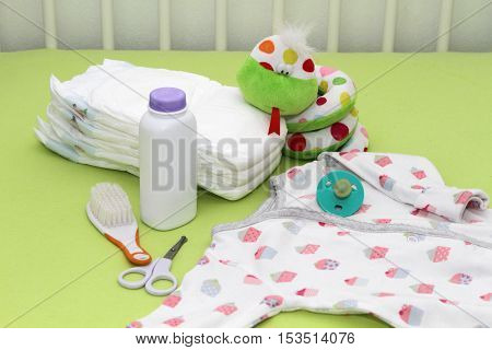 accessories for baby diapers baby comb scissors nipple pacifier body shirt soft toy snake against the bed