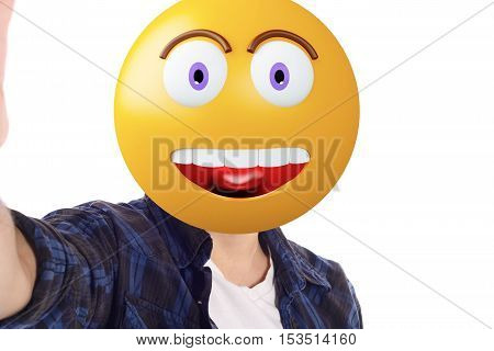 Portrait of an emoji head man taking selfie. Isolated white background.