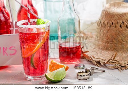 Cold summer drink with mint leaf on wooden table