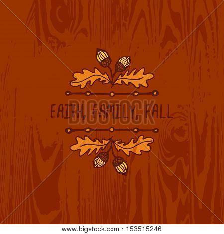 Hand-sketched typographic element with acorns and text on wooden background. Faith family fall