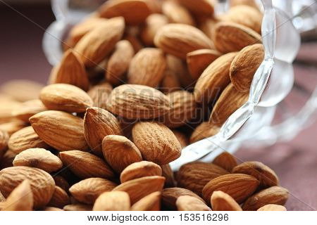 Whole Almonds falling from the bowl - Prunus dulcis