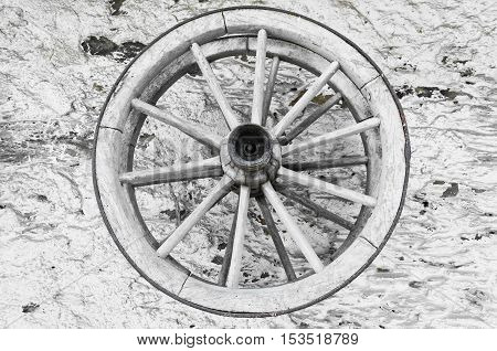 Two wooden spoked wheels on the wall of country house in western Bohemia