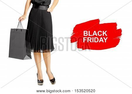 people, sale, black Friday and luxury concept - woman in black dress with shopping bags isolated on white background.