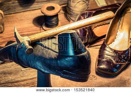Vintage Shoemaker Workplace With Tools, Shoes And Leather