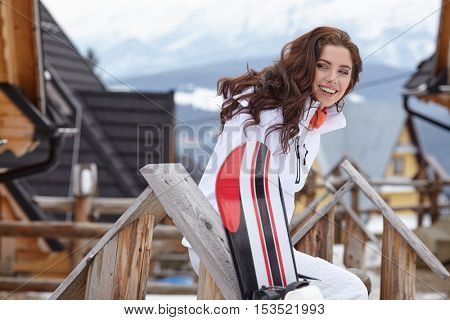 woman winter outdoor snowboarding concept