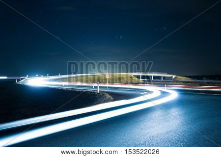 Road with car lights at night