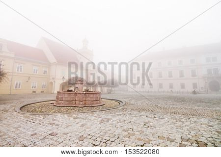 Foggy day in old european town center