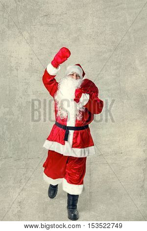 Santa Claus Going With A Bag Of Gifts.