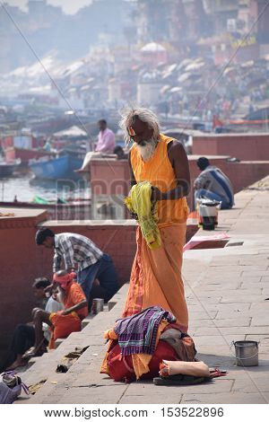 VARANASI, UTTAR PRADESH, INDIA - FEBRUARY 17, 2016 - Unidentified Sadhu with traditional painted face dressing on the ghats of Varanasi, the spiritual capital of India