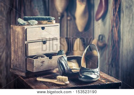 Old Shoemaker Workshop With Tools, Shoes And Leather