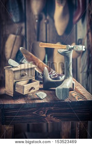 Old Cobbler Workshop With Tools, Shoes And Laces